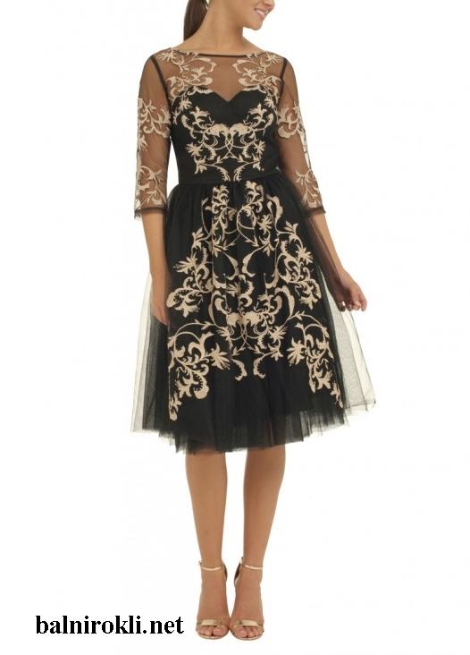 елегантна черна рокля със златиста бродерия